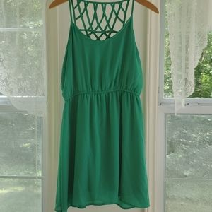 Green spaghetti strap dress with details on back